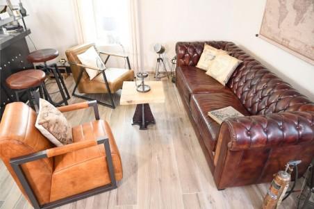 Fauteuil en cuir beige couleur camel sombre et noir cuba vintage design métal déco indus loft